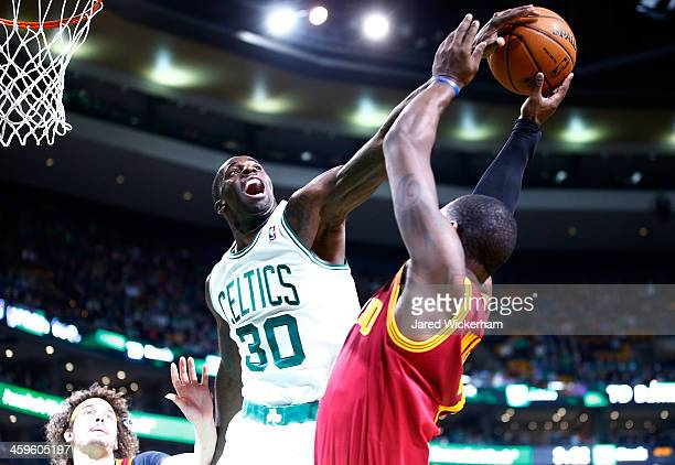 Brandon Bass of the Boston Celtics blocks the shot of Dion Waiters of the Cleveland Cavaliers in the final seconds of the fourth quarter during the...