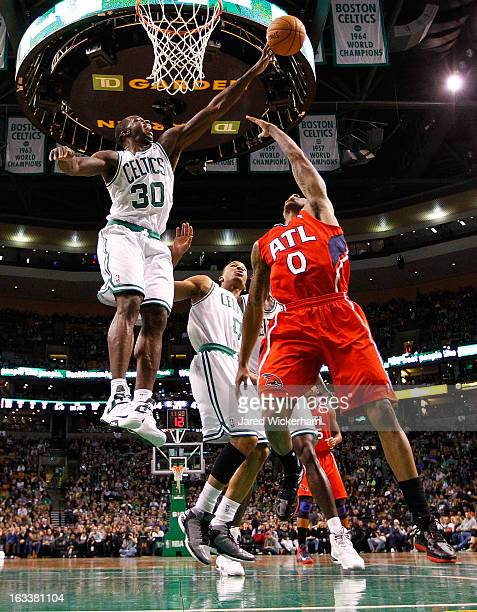 Brandon Bass of the Boston Celtics blocks the shot of Jeff Teague of the Atlanta Hawks during the game on March 8 2013 at TD Garden in Boston...