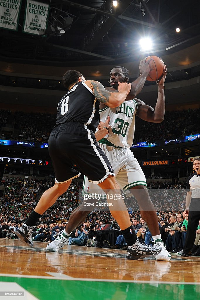 <a gi-track='captionPersonalityLinkClicked' href=/galleries/search?phrase=Brandon+Bass&family=editorial&specificpeople=233806 ng-click='$event.stopPropagation()'>Brandon Bass</a> #30 of the Boston Celtics controls the ball against <a gi-track='captionPersonalityLinkClicked' href=/galleries/search?phrase=Deron+Williams&family=editorial&specificpeople=203215 ng-click='$event.stopPropagation()'>Deron Williams</a> #8 of the Brooklyn Nets on April 10, 2013 at the TD Garden in Boston, Massachusetts.