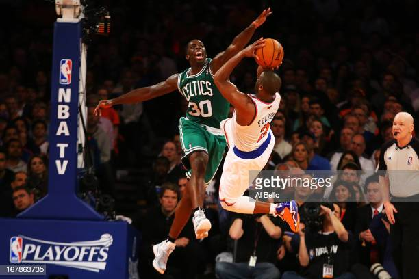 Brandon Bass of the Boston Celtics defends against Raymond Felton of the New York Knicks during Game five of the Eastern Conference Quarterfinals of...