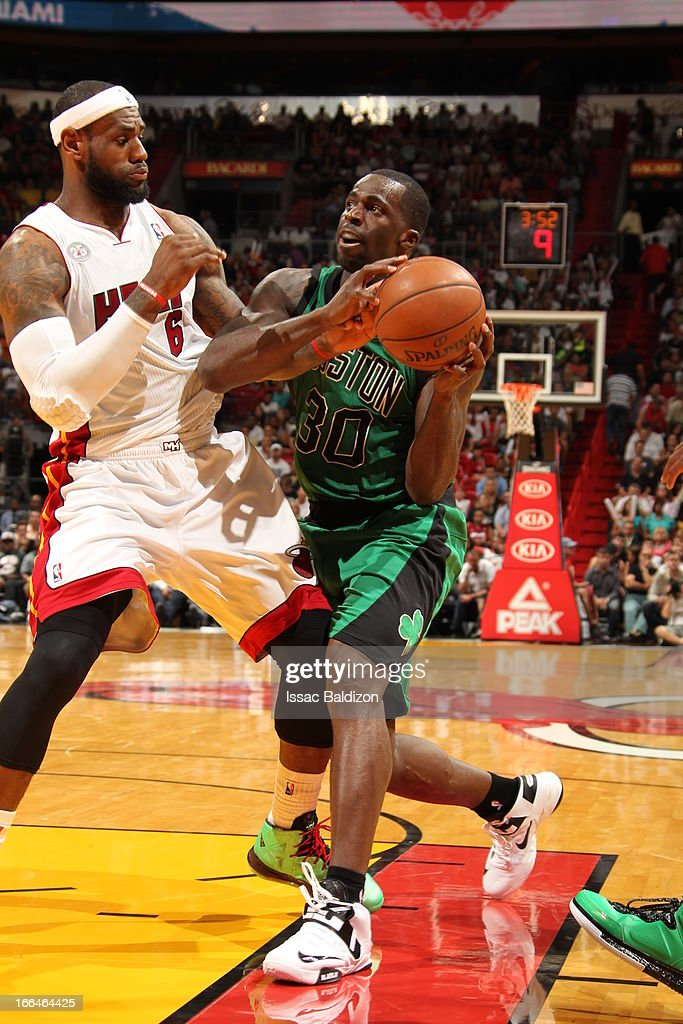 <a gi-track='captionPersonalityLinkClicked' href=/galleries/search?phrase=Brandon+Bass&family=editorial&specificpeople=233806 ng-click='$event.stopPropagation()'>Brandon Bass</a> #30 of the Boston Celtics drives to the basket against <a gi-track='captionPersonalityLinkClicked' href=/galleries/search?phrase=LeBron+James&family=editorial&specificpeople=201474 ng-click='$event.stopPropagation()'>LeBron James</a> #6 of the Miami Heat on April 12, 2013 at American Airlines Arena in Miami, Florida.