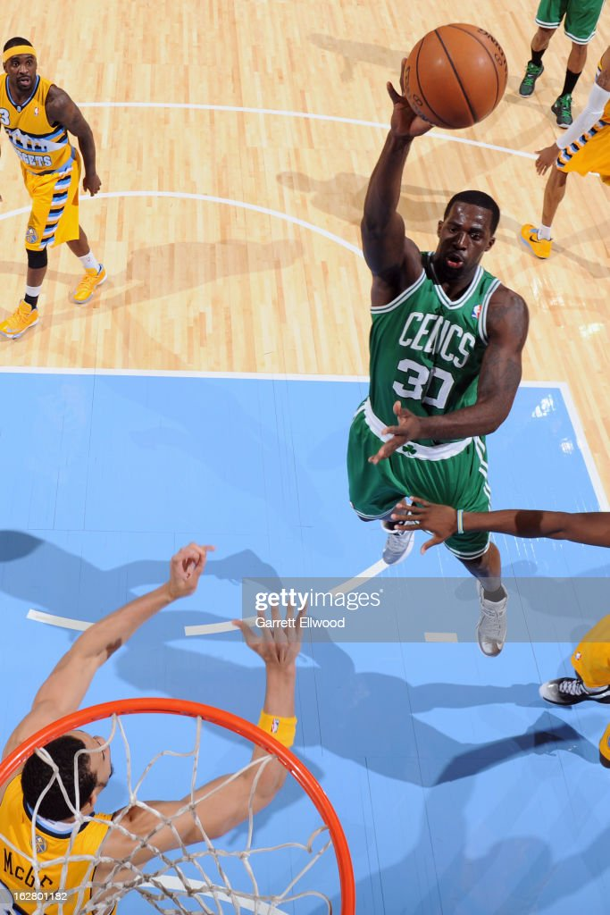 Brandon Bass #30 of the Boston Celtics drives to the basket against the Denver Nuggets on February 19, 2013 at the Pepsi Center in Denver, Colorado.