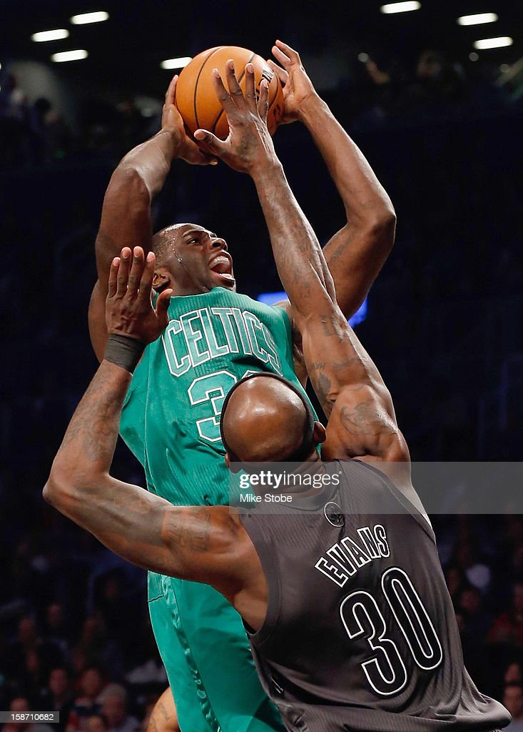 Brandon Bass #30 of the Boston Celtics drives to the net against Reggie Evans #30 of the Brooklyn Nets at the Barclays Center on December 25, 2012 in the Brooklyn borough of New York City.