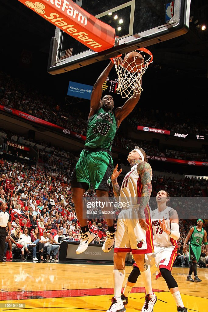<a gi-track='captionPersonalityLinkClicked' href=/galleries/search?phrase=Brandon+Bass&family=editorial&specificpeople=233806 ng-click='$event.stopPropagation()'>Brandon Bass</a> #30 of the Boston Celtics dunks against Chris Andersen #11 of the Miami Heat on April 12, 2013 at American Airlines Arena in Miami, Florida.