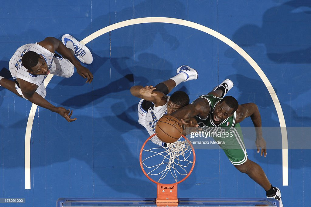 <a gi-track='captionPersonalityLinkClicked' href=/galleries/search?phrase=Brandon+Bass&family=editorial&specificpeople=233806 ng-click='$event.stopPropagation()'>Brandon Bass</a> #30 of the Boston Celtics dunks against <a gi-track='captionPersonalityLinkClicked' href=/galleries/search?phrase=DeQuan+Jones&family=editorial&specificpeople=5626127 ng-click='$event.stopPropagation()'>DeQuan Jones</a> #20 of the Orlando Magic on April 13, 2013 at Amway Center in Orlando, Florida.