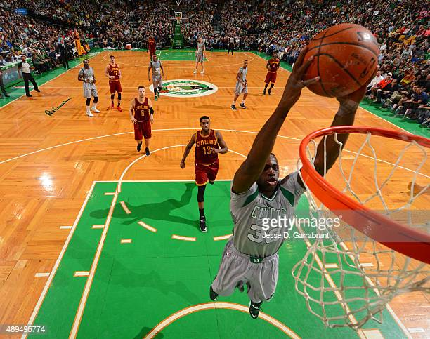 Brandon Bass of the Boston Celtics dunks the ball against the Cleveland Cavilers at the TD Garden on April 12 2015 in Boston MassachusettsNOTE TO...