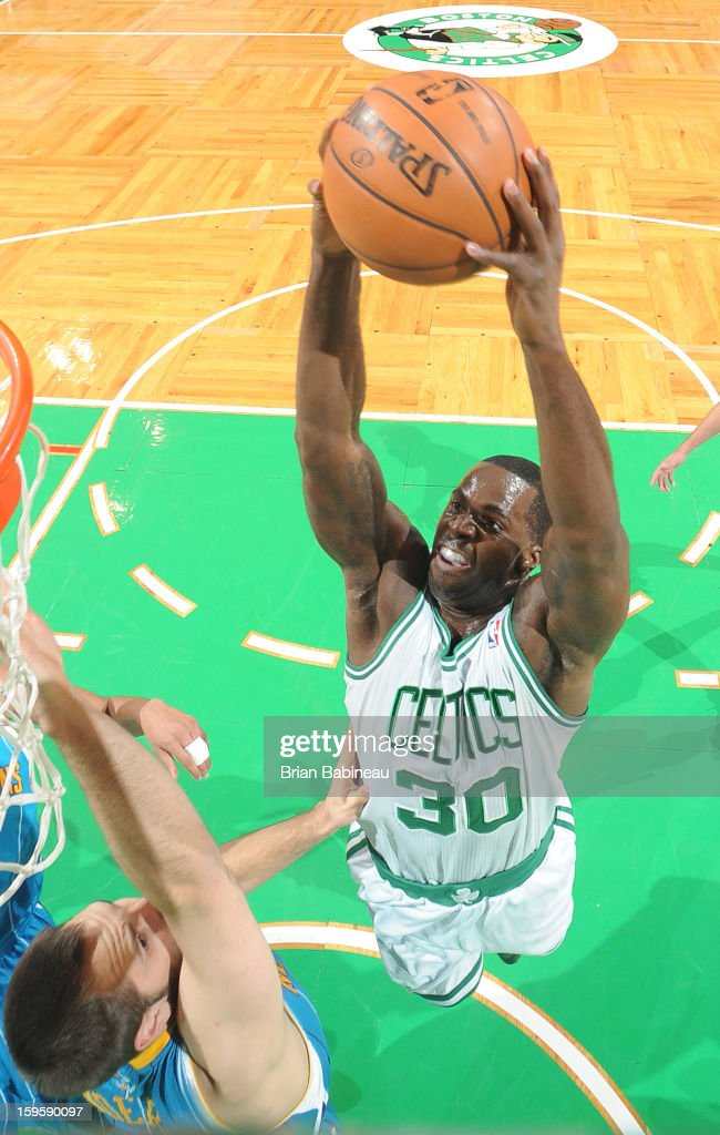 <a gi-track='captionPersonalityLinkClicked' href=/galleries/search?phrase=Brandon+Bass&family=editorial&specificpeople=233806 ng-click='$event.stopPropagation()'>Brandon Bass</a> #30 of the Boston Celtics dunks the ball against the New Orleans Hornets on January 16, 2013 at the TD Garden in Boston, Massachusetts.