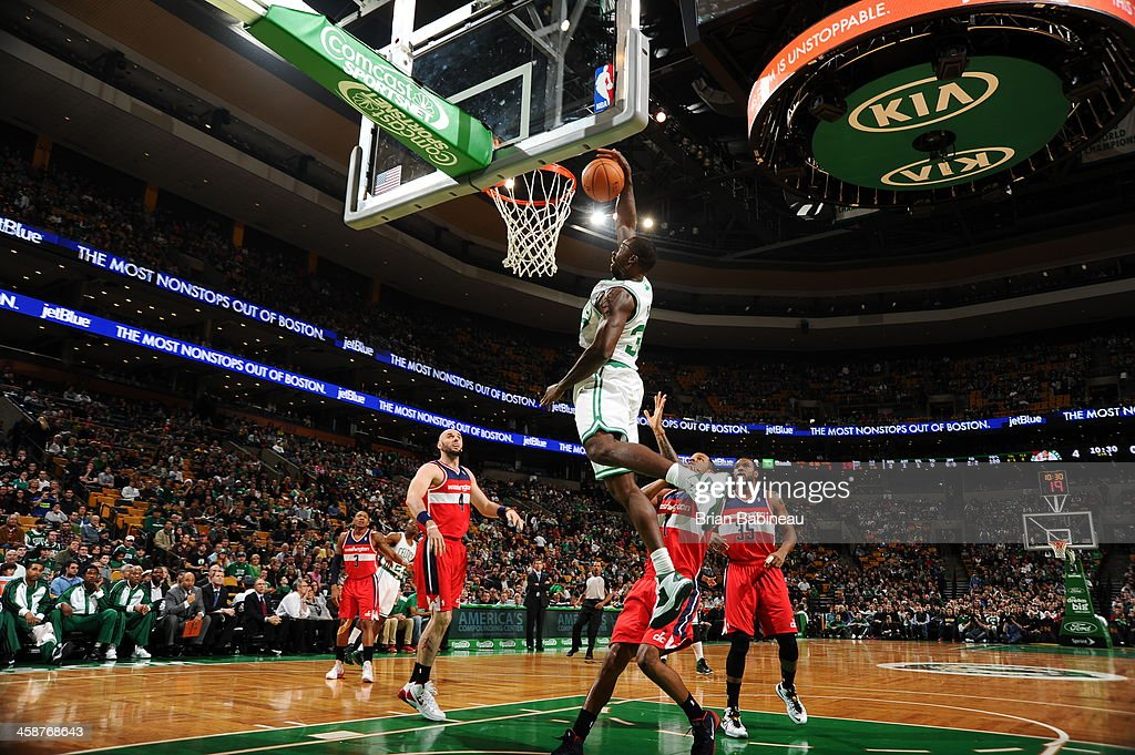 Brandon Bass #30 of the Boston Celtics dunks the ball against the Washington Wizards on December 21, 2013 at the TD Garden in Boston, Massachusetts.