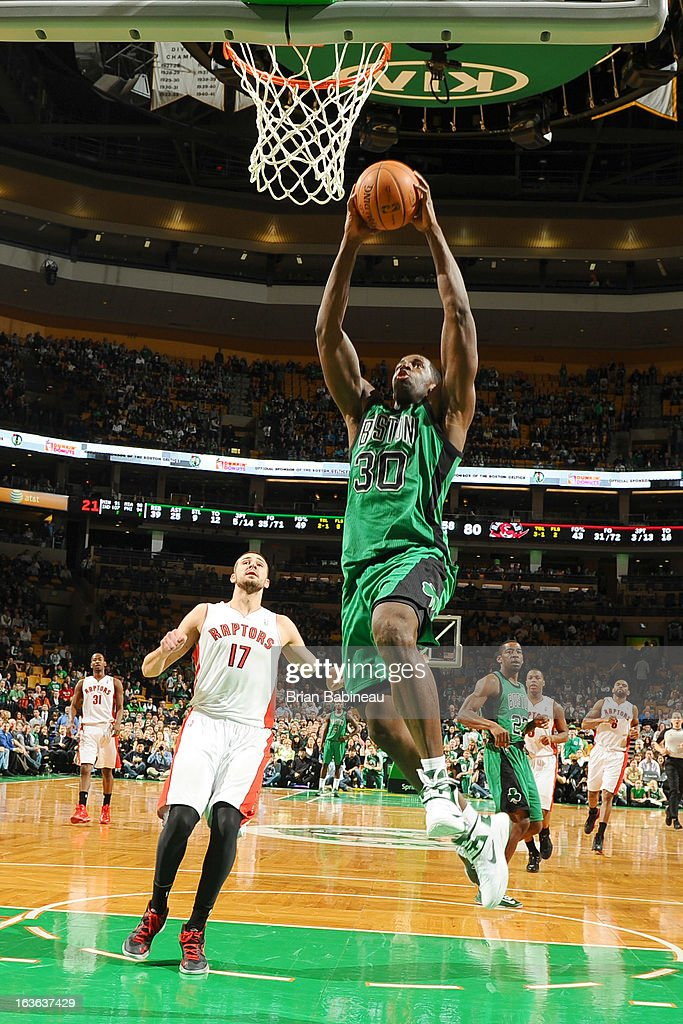 Brandon Bass #30 of the Boston Celtics dunks the ball against the Toronto Raptors on March 13, 2013 at the TD Garden in Boston, Massachusetts.