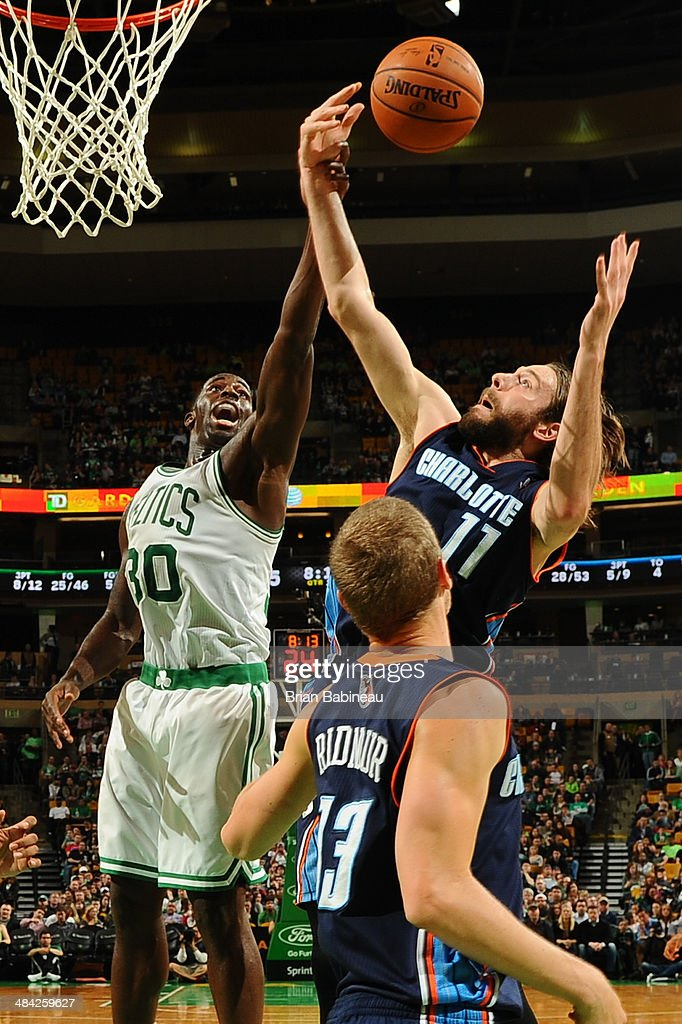 <a gi-track='captionPersonalityLinkClicked' href=/galleries/search?phrase=Brandon+Bass&family=editorial&specificpeople=233806 ng-click='$event.stopPropagation()'>Brandon Bass</a> #30 of the Boston Celtics fights for the ball against <a gi-track='captionPersonalityLinkClicked' href=/galleries/search?phrase=Josh+McRoberts&family=editorial&specificpeople=732530 ng-click='$event.stopPropagation()'>Josh McRoberts</a> #11 of the Charlotte Bobcats on April 11, 2014 at the TD Garden in Boston, Massachusetts.
