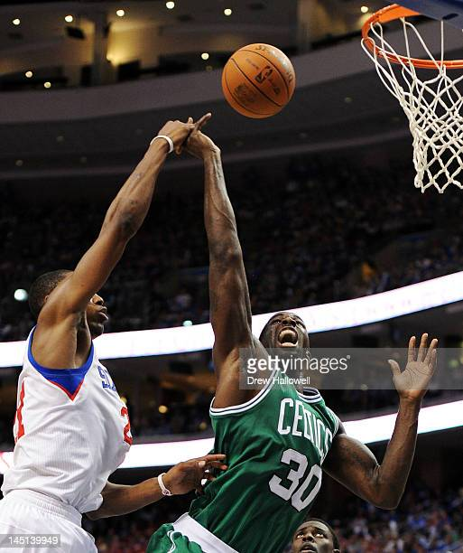 Brandon Bass of the Boston Celtics gets his hand tied up by Thaddeus Young of the Philadelphia 76ers in Game Six of the Eastern Conference Semifinals...