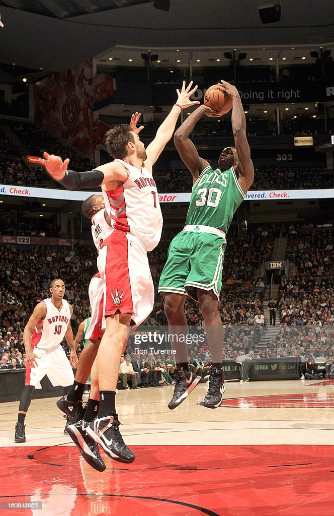 Brandon Bass #30 of the Boston Celtics goes for a jump shot against Andrea Bargnani #7 of the Toronto Raptors during the game between the the Toronto Raptors and the Boston Celtics on February 6, 2013 at the Air Canada Centre in Toronto, Ontario, Canada.