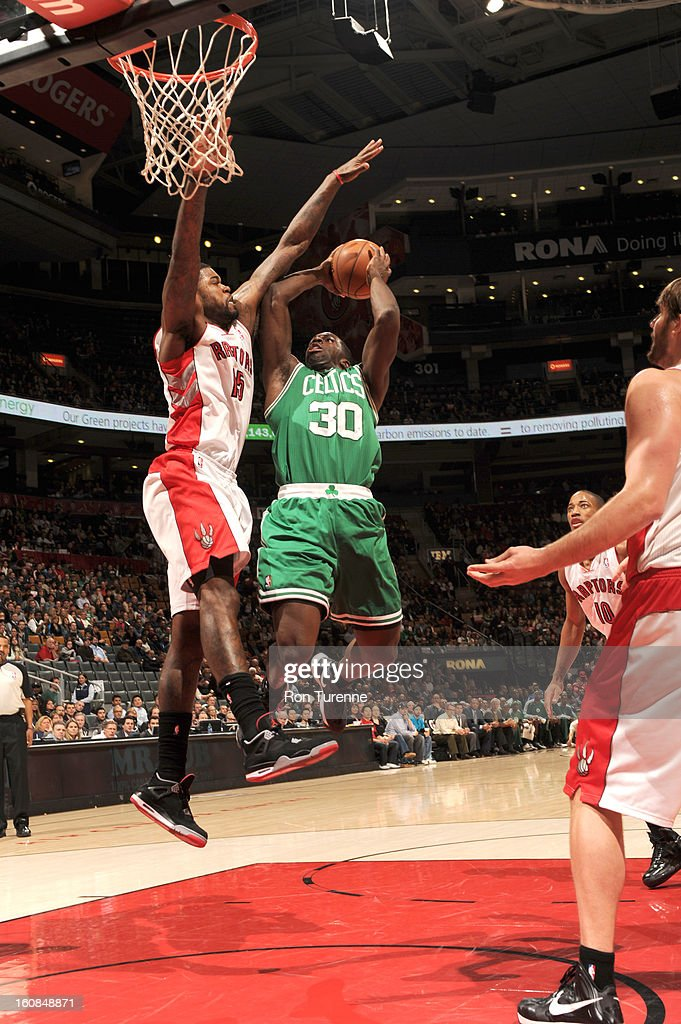 Brandon Bass #30 of the Boston Celtics goes to the basket against Amir Johnson #15 of the Toronto Raptors during the game between the the Toronto Raptors and the Boston Celtics on February 6, 2013 at the Air Canada Centre in Toronto, Ontario, Canada.