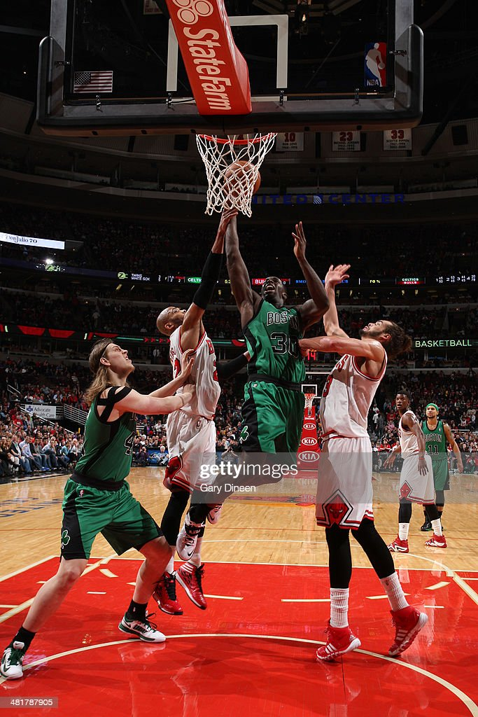 Brandon Bass #30 of the Boston Celtics goes to the basket against the Chicago Bulls on March 31, 2014 at the United Center in Chicago, Illinois.