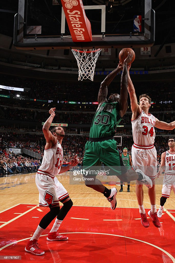 <a gi-track='captionPersonalityLinkClicked' href=/galleries/search?phrase=Brandon+Bass&family=editorial&specificpeople=233806 ng-click='$event.stopPropagation()'>Brandon Bass</a> #30 of the Boston Celtics goes to the basket against the Chicago Bulls on March 31, 2014 at the United Center in Chicago, Illinois.