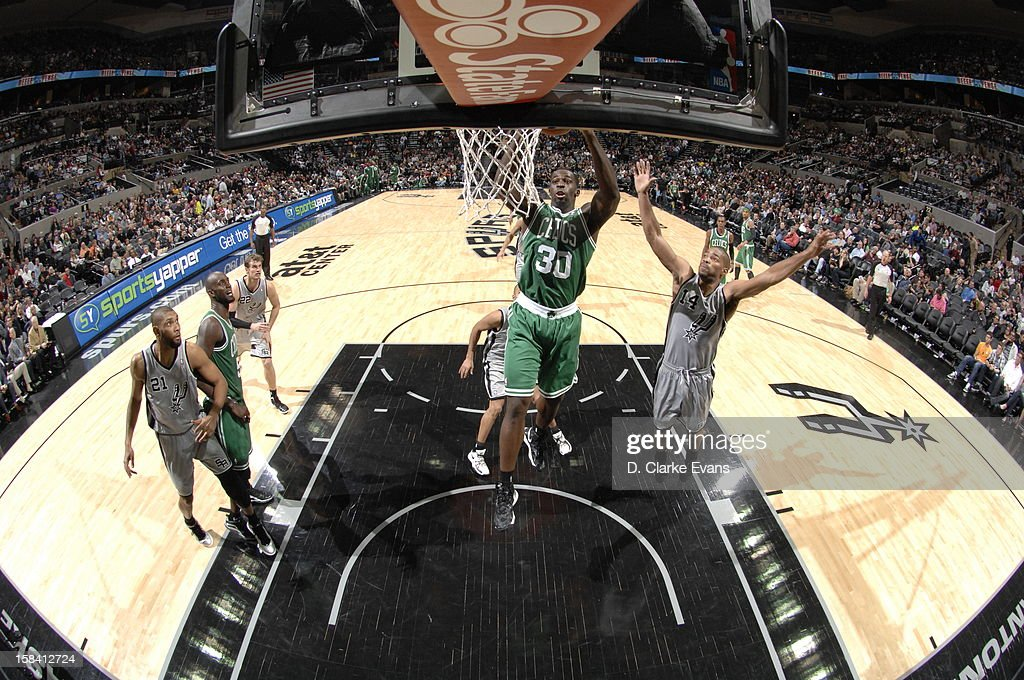 <a gi-track='captionPersonalityLinkClicked' href=/galleries/search?phrase=Brandon+Bass&family=editorial&specificpeople=233806 ng-click='$event.stopPropagation()'>Brandon Bass</a> #30 of the Boston Celtics goes to the basket during the game between the Boston Celtics and the San Antonio Spurs on December 15, 2012 at the AT&T Center in San Antonio, Texas.