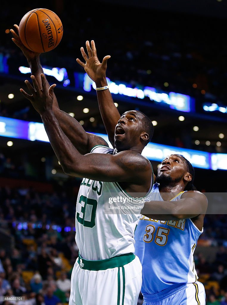 <a gi-track='captionPersonalityLinkClicked' href=/galleries/search?phrase=Brandon+Bass&family=editorial&specificpeople=233806 ng-click='$event.stopPropagation()'>Brandon Bass</a> #30 of the Boston Celtics goes up for a layup in front of <a gi-track='captionPersonalityLinkClicked' href=/galleries/search?phrase=Kenneth+Faried&family=editorial&specificpeople=5765135 ng-click='$event.stopPropagation()'>Kenneth Faried</a> #35 of the Denver Nuggets in the first quarter during the game at TD Garden on December 6, 2013 in Boston, Massachusetts.