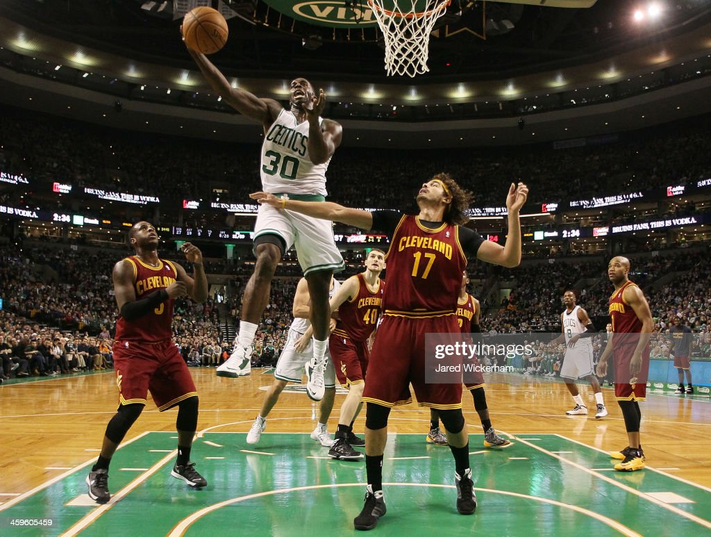 Brandon Bass #30 of the Boston Celtics goes up for a layup in front of Anderson Verejao #17 of the Cleveland Cavaliers in the second half during the game at TD Garden on December 28, 2013 in Boston, Massachusetts.