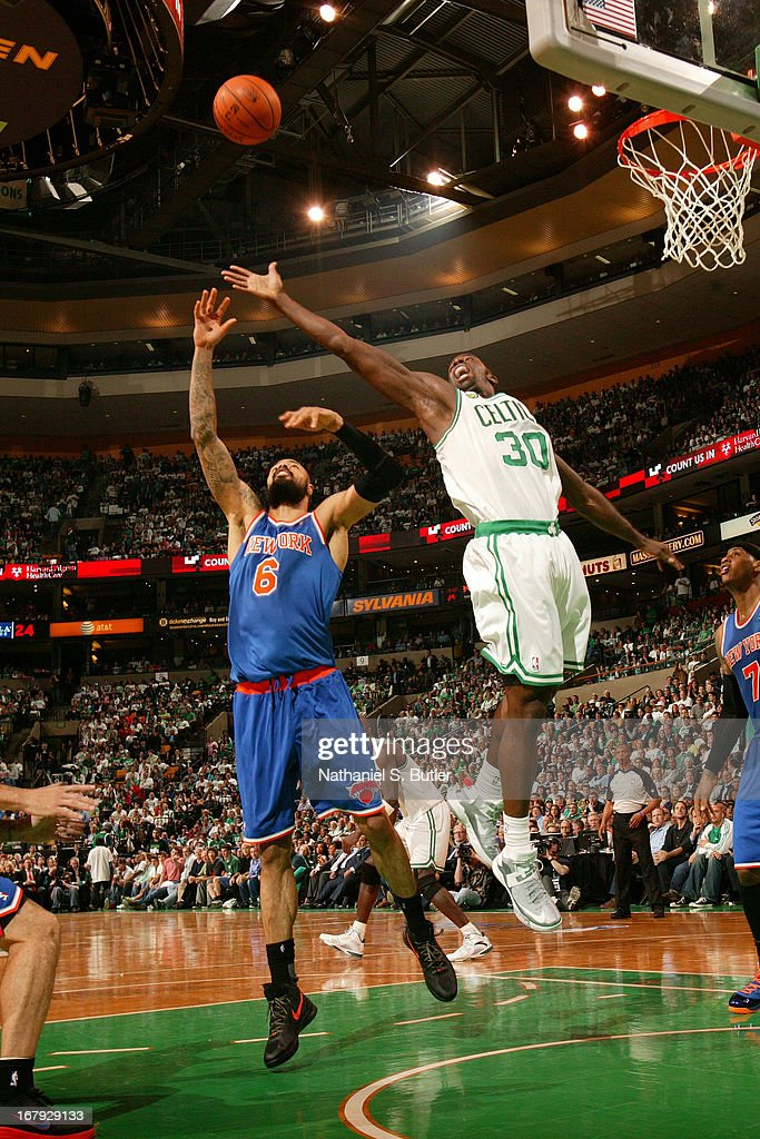 Brandon Bass #30 of the Boston Celtics goes up for a rebound against Tyson Chandler #6 of the New York Knicks in Game Three of the Eastern Conference Quarterfinals during the 2013 NBA Playoffs on April 26, 2013 at the TD Garden in Boston.