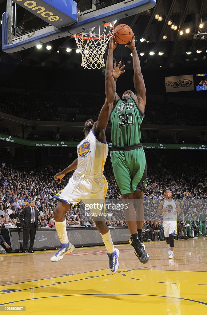 Brandon Bass #30 of the Boston Celtics goes up for the dunk against Draymond Green #23 of the Golden State Warriors on December 29, 2012 at Oracle Arena in Oakland, California.