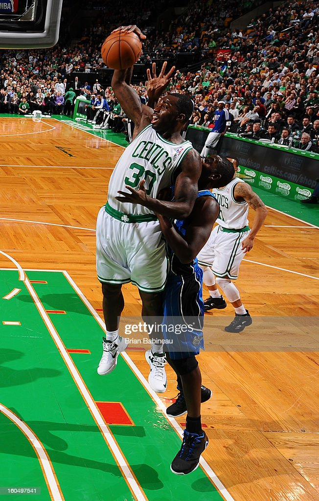 <a gi-track='captionPersonalityLinkClicked' href=/galleries/search?phrase=Brandon+Bass&family=editorial&specificpeople=233806 ng-click='$event.stopPropagation()'>Brandon Bass</a> #30 of the Boston Celtics grabs a rebound against the Orlando Magic on February 1, 2013 at the TD Garden in Boston, Massachusetts.