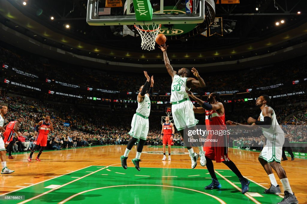 <a gi-track='captionPersonalityLinkClicked' href=/galleries/search?phrase=Brandon+Bass&family=editorial&specificpeople=233806 ng-click='$event.stopPropagation()'>Brandon Bass</a> #30 of the Boston Celtics grabs a rebound against the Washington Wizards on December 21, 2013 at the TD Garden in Boston, Massachusetts.