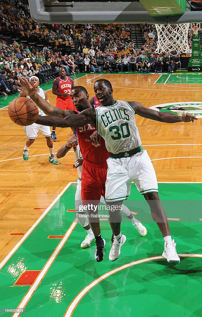 <a gi-track='captionPersonalityLinkClicked' href=/galleries/search?phrase=Brandon+Bass&family=editorial&specificpeople=233806 ng-click='$event.stopPropagation()'>Brandon Bass</a> #30 of the Boston Celtics grabs the rebound against the Philadelphia 76ers on October 21, 2012 at the TD Garden in Boston, Massachusetts.