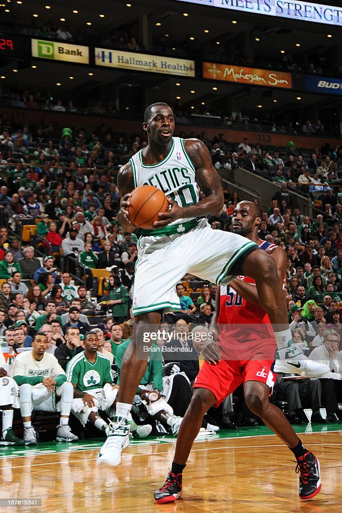 <a gi-track='captionPersonalityLinkClicked' href=/galleries/search?phrase=Brandon+Bass&family=editorial&specificpeople=233806 ng-click='$event.stopPropagation()'>Brandon Bass</a> #30 of the Boston Celtics grabs the rebound against the Washington Wizards on April 7, 2013 at the TD Garden in Boston, Massachusetts.