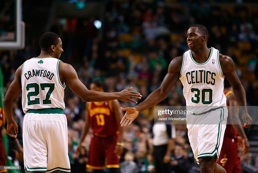 <a gi-track='captionPersonalityLinkClicked' href=/galleries/search?phrase=Brandon+Bass&family=editorial&specificpeople=233806 ng-click='$event.stopPropagation()'>Brandon Bass</a> #30 of the Boston Celtics is congratulated by teammate <a gi-track='captionPersonalityLinkClicked' href=/galleries/search?phrase=Jordan+Crawford&family=editorial&specificpeople=4779380 ng-click='$event.stopPropagation()'>Jordan Crawford</a> #27 in the second half against the Cleveland Cavalier during the game at TD Garden on December 28, 2013 in Boston, Massachusetts.