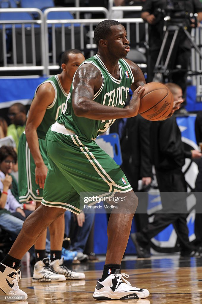 <a gi-track='captionPersonalityLinkClicked' href=/galleries/search?phrase=Brandon+Bass&family=editorial&specificpeople=233806 ng-click='$event.stopPropagation()'>Brandon Bass</a> #30 of the Boston Celtics passes the ball against the Orlando Magic on April 13, 2013 at Amway Center in Orlando, Florida.