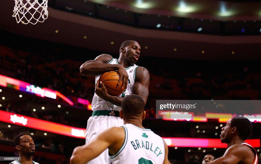 Brandon Bass #30 of the Boston Celtics pulls in a rebound against the Milwaukee Bucks in the fourth quarter during the game at TD Garden on December 3, 2013 in Boston, Massachusetts.