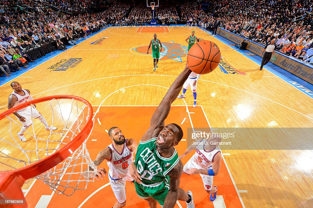 Brandon Bass #30 of the Boston Celtics reaches for a rebound against Tyson Chandler #6 of the New York Knicks in Game Five of the Eastern Conference Quarterfinals during the 2013 NBA Playoffs on May 1, 2013 at Madison Square Garden in New York City.
