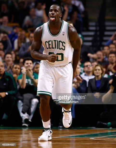 Brandon Bass of the Boston Celtics reacts following a basket in the fourth quarter against the Milwaukee Bucks during the game at TD Garden on...
