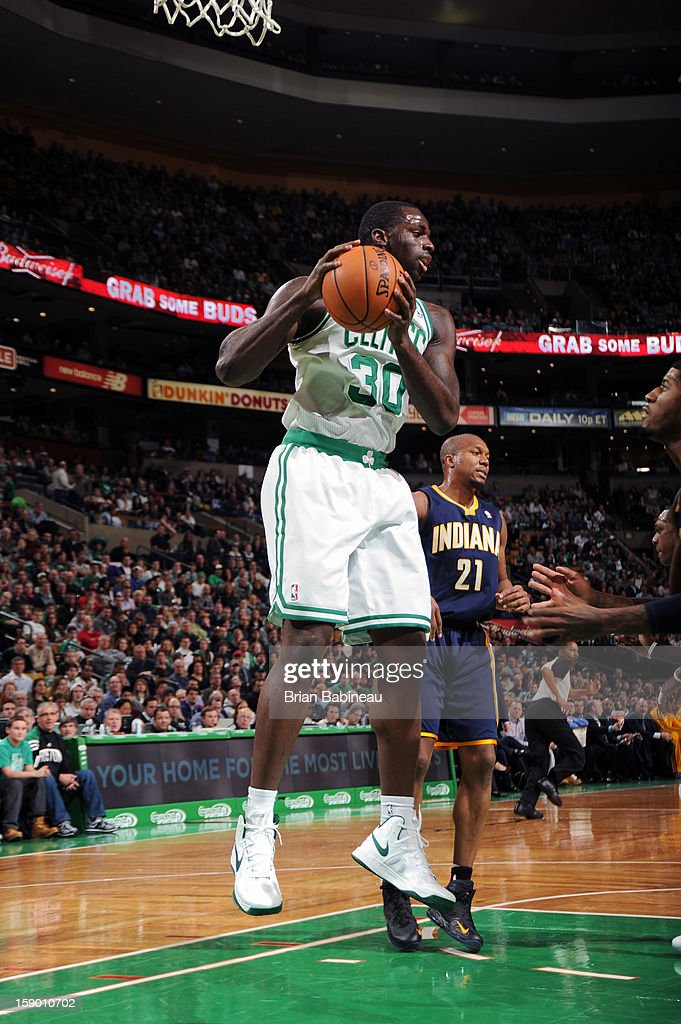 Brandon Bass #30 of the Boston Celtics rebounds against the Indiana Pacers on January 4, 2013 at the TD Garden in Boston, Massachusetts.
