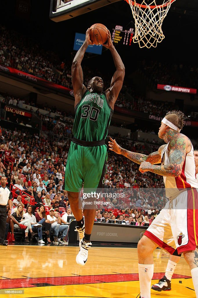 <a gi-track='captionPersonalityLinkClicked' href=/galleries/search?phrase=Brandon+Bass&family=editorial&specificpeople=233806 ng-click='$event.stopPropagation()'>Brandon Bass</a> #30 of the Boston Celtics rises for a dunk against Chris Andersen #11 of the Miami Heat on April 12, 2013 at American Airlines Arena in Miami, Florida.