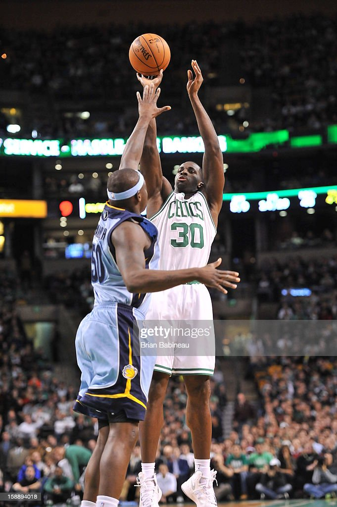 Brandon Bass #30 of the Boston Celtics shoots a deep shot against the Memphis Grizzlies on January 2, 2013 at the TD Garden in Boston, Massachusetts.