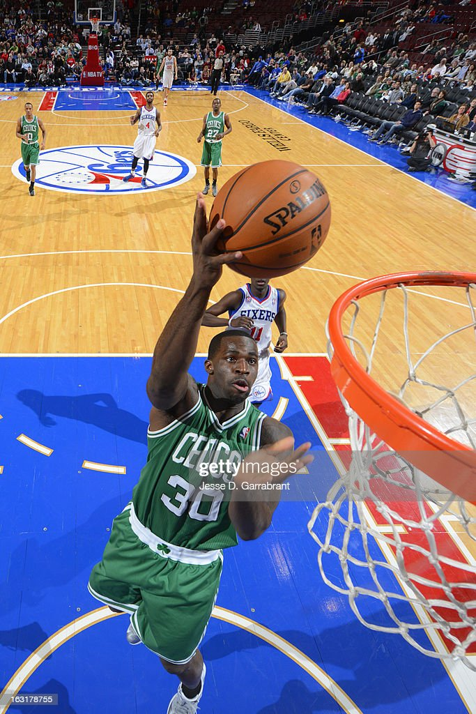 Brandon Bass #30 of the Boston Celtics shoots a layup against the Philadelphia 76ers on March 5, 2013 at the Wells Fargo Center in Philadelphia, Pennsylvania.