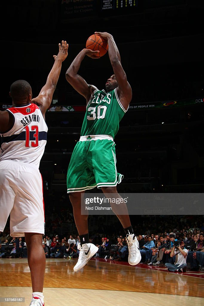<a gi-track='captionPersonalityLinkClicked' href=/galleries/search?phrase=Brandon+Bass&family=editorial&specificpeople=233806 ng-click='$event.stopPropagation()'>Brandon Bass</a> #30 of the Boston Celtics shoots against <a gi-track='captionPersonalityLinkClicked' href=/galleries/search?phrase=Kevin+Seraphin&family=editorial&specificpeople=6474998 ng-click='$event.stopPropagation()'>Kevin Seraphin</a> #13 of the Washington Wizards during the game between the Washington Wizards and the Boston Celtics at the Verizon Center on January 22, 2012 in Washington, DC.