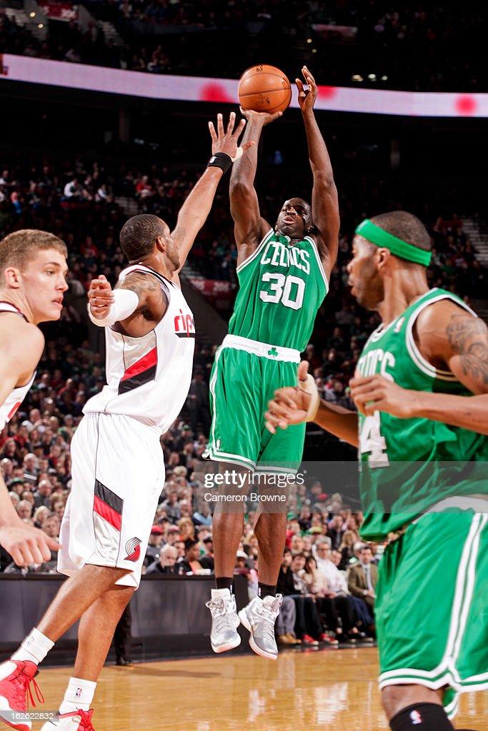 Brandon Bass #30 of the Boston Celtics shoots against LaMarcus Aldridge #12 of the Portland Trail Blazers on February 24, 2013 at the Rose Garden Arena in Portland, Oregon.