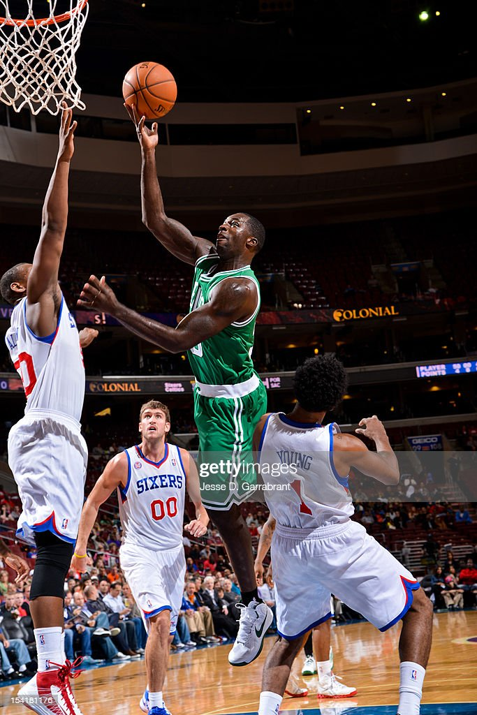 Brandon Bass #30 of the Boston Celtics shoots against Lavoy Allen #50 of the Philadelphia 76ers during a pre-season game at the Wells Fargo Center on October 15, 2012 in Philadelphia, Pennsylvania.