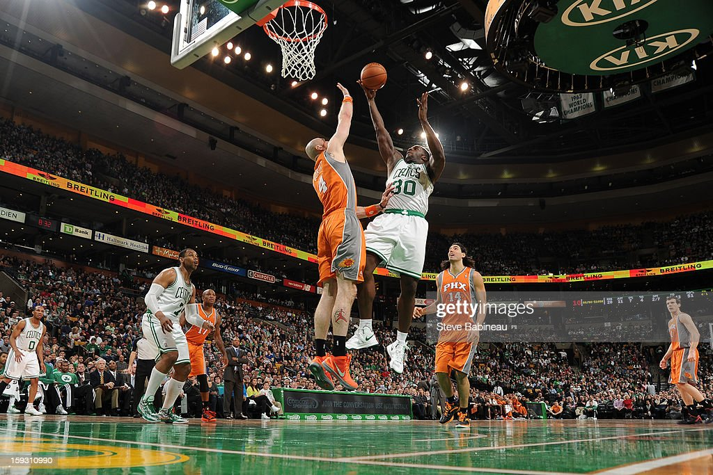 <a gi-track='captionPersonalityLinkClicked' href=/galleries/search?phrase=Brandon+Bass&family=editorial&specificpeople=233806 ng-click='$event.stopPropagation()'>Brandon Bass</a> #30 of the Boston Celtics shoots against <a gi-track='captionPersonalityLinkClicked' href=/galleries/search?phrase=Marcin+Gortat&family=editorial&specificpeople=589986 ng-click='$event.stopPropagation()'>Marcin Gortat</a> #4 of the Phoenix Suns on January 9, 2013 at the TD Garden in Boston, Massachusetts.