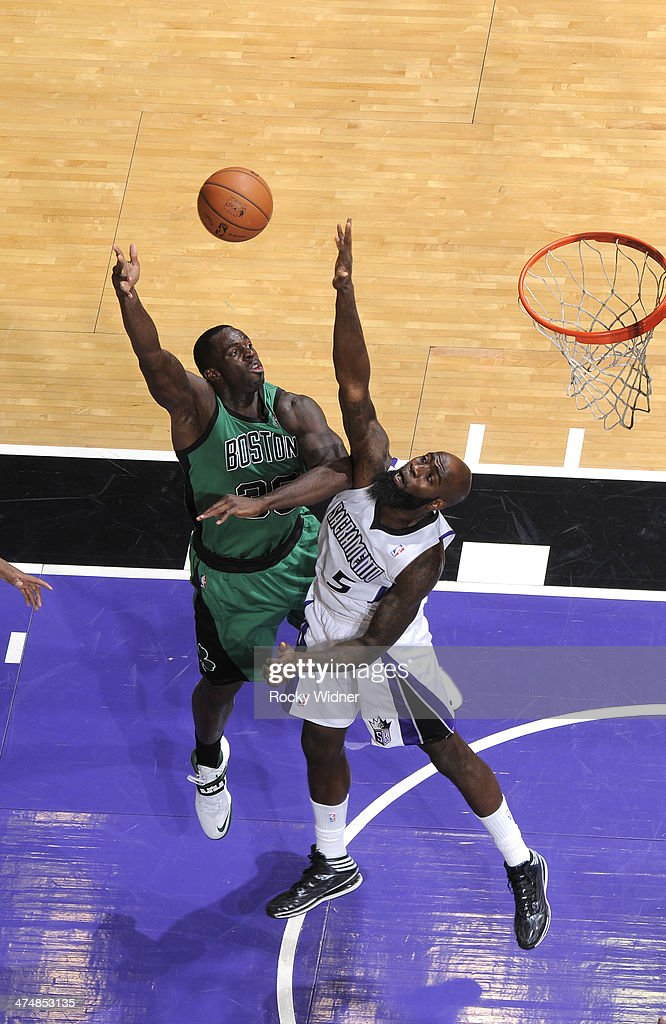 <a gi-track='captionPersonalityLinkClicked' href=/galleries/search?phrase=Brandon+Bass&family=editorial&specificpeople=233806 ng-click='$event.stopPropagation()'>Brandon Bass</a> #30 of the Boston Celtics shoots against <a gi-track='captionPersonalityLinkClicked' href=/galleries/search?phrase=Quincy+Acy&family=editorial&specificpeople=5674079 ng-click='$event.stopPropagation()'>Quincy Acy</a> #5 of the Sacramento Kings on February 22, 2014 at Sleep Train Arena in Sacramento, California.