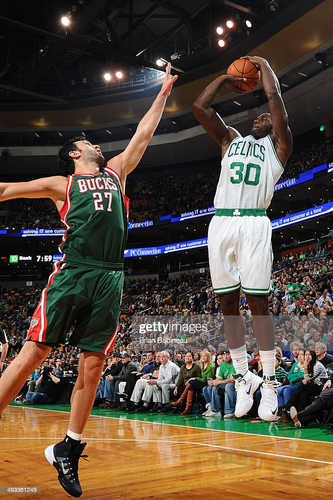 Brandon Bass #30 of the Boston Celtics shoots against Zaza Pachulia #27 of the Milwaukee Bucks on December 3, 2013 at the TD Garden in Boston, Massachusetts.