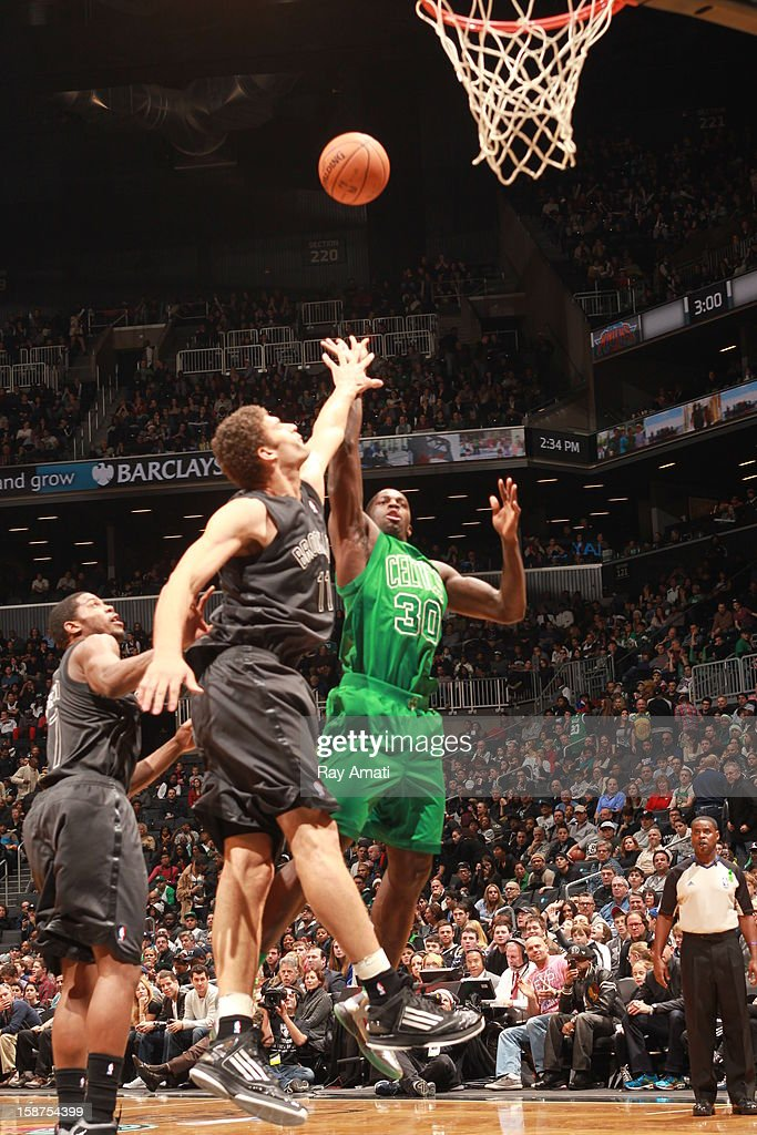 Brandon Bass #30 of the Boston Celtics shoots the ball against Brook Lopez #11 of the Brooklyn Nets on December 25, 2012 at the Barclays Center in Brooklyn, New York.