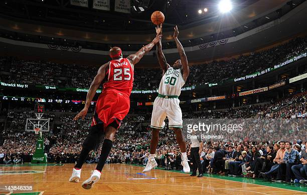 Brandon Bass of the Boston Celtics shoots the ball against Erick Dampier of the Atlanta Hawks in Game Three of the Eastern Conference Quarterfinals...