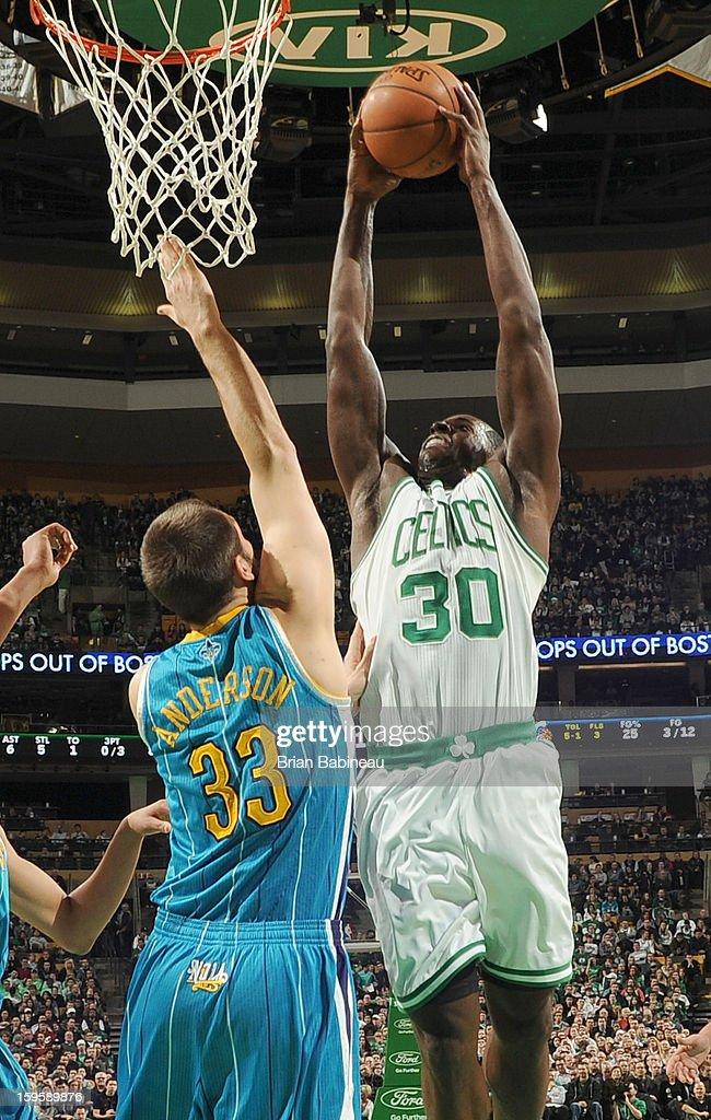 Brandon Bass #30 of the Boston Celtics shoots the ball against the New Orleans Hornets on January 16, 2013 at the TD Garden in Boston, Massachusetts.