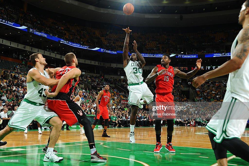 Brandon Bass #30 of the Boston Celtics shoots the ball against the Toronto Raptors on October 7, 2013 at the TD Garden in Boston, Massachusetts.