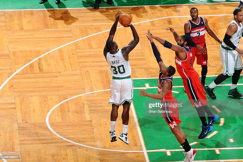Brandon Bass #30 of the Boston Celtics shoots the ball against the Washington Wizards on December 21, 2013 at the TD Garden in Boston, Massachusetts.