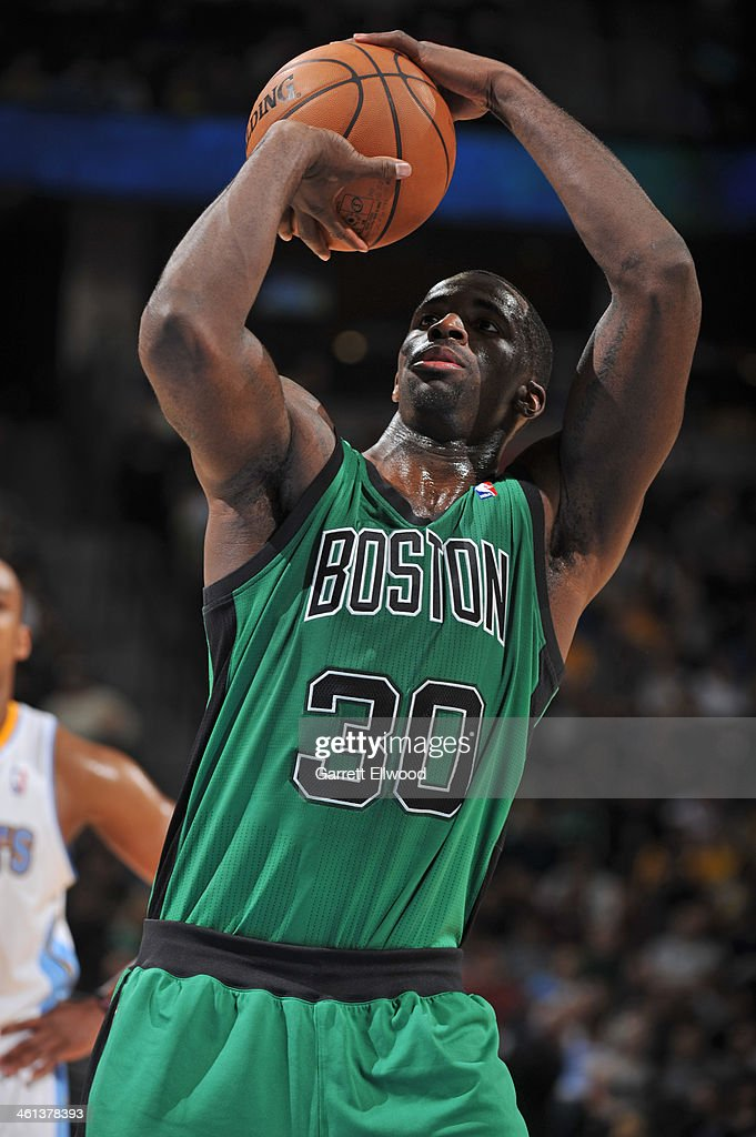 <a gi-track='captionPersonalityLinkClicked' href=/galleries/search?phrase=Brandon+Bass&family=editorial&specificpeople=233806 ng-click='$event.stopPropagation()'>Brandon Bass</a> #30 of the Boston Celtics takes a free throw against the Denver Nuggets on January 7, 2014 at the Pepsi Center in Denver, Colorado.