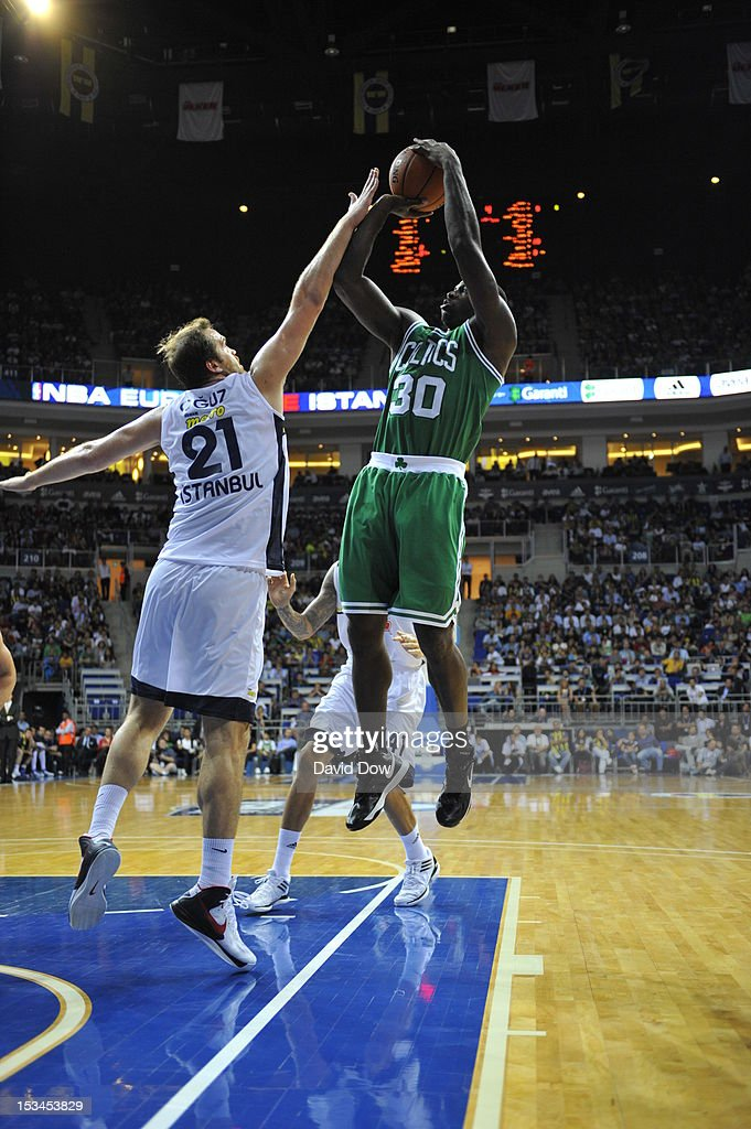 <a gi-track='captionPersonalityLinkClicked' href=/galleries/search?phrase=Brandon+Bass&family=editorial&specificpeople=233806 ng-click='$event.stopPropagation()'>Brandon Bass</a> #30 of the Boston Celtics takes a shot against Savas Oguz #21 of the Fenerbahce Ulker during the NBA Europe Live Tour on October 5, 2012 at the Ulker Sports Arena in Istanbul, Asia.